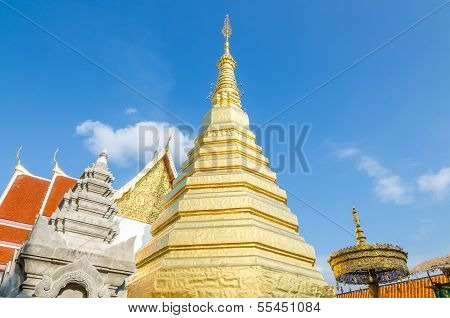 Golden Pagoda at Wat Phra That Cho Hae (the Royal Temple) Phrae Province Thailand poster