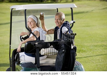 Senior happy couple on the golf cart