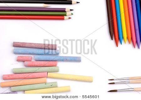Colorful pencils crayons chalks and paintbrushes