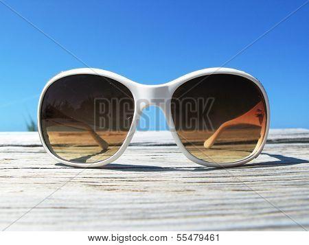 Sunglasses on the wooden jetty. Exuma, Bahamas  poster