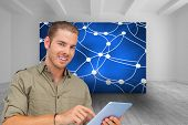 Composite image of happy man using tablet pc poster