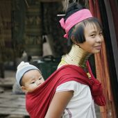 Long neck women with a child in a village in Mae Hong Son poster