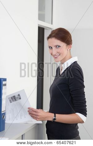 Young Clerk Checks Documents