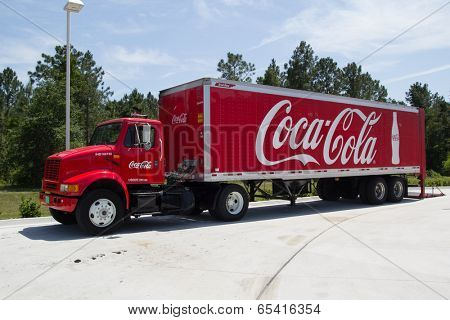 JACKSONVILLE, FL - MAY 20, 2014: A red Coca cola truck. The Coca-Cola Company is an American beverage corporation best known for its flagship product Coca-Cola, invented in 1886 by a pharmacist.