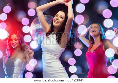 new year, celebration, friends, bachelorette party, birthday concept - three beautiful woman in evening dresses dancing in the club