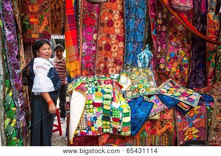 Otavalo, August 4, 2012: Indian Women In National Clothes Sells The Products Of Her Weaving, As Usua