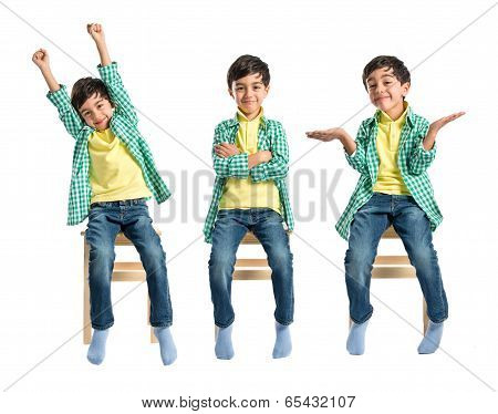 Happy Brunette Kid On Wooden Chair Over White