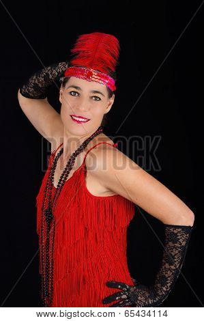 Young Beautiful Brunette In 1920 Style Attire Red Dress And A Feather