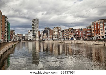 Derivation Of River Meuse Under Cloudy Sky In Liege