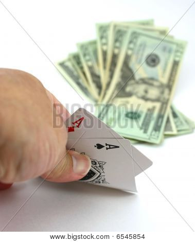 Poker player views pocket pair aces poker, cash bet