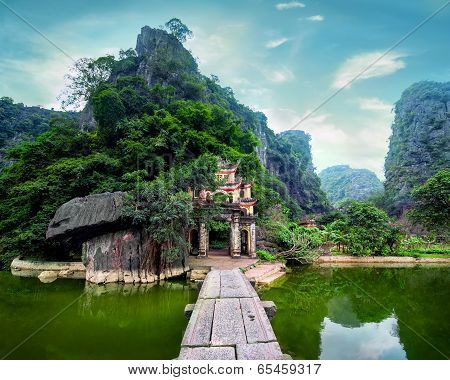 Outdoor Park Landscape With Lake And Stone Bridge. Gate Entrance To Bich Dong Pagoda. Vietnam
