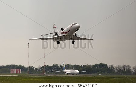 Departing International Jet Management Dassault Falcon 900EX aircraft in the rainy day