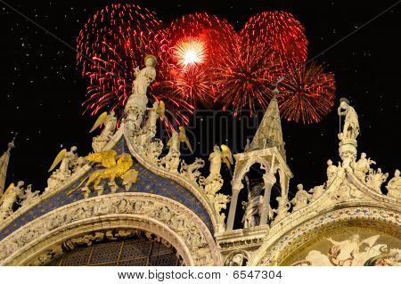 Detail of facade of Saint Mark's cathedral in Venice Italy with Holiday fireworks exploding in the background. ** Note: Shallow depth of field poster