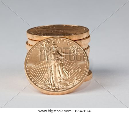 Stack Of Pure Gold Coins With Liberty Facing