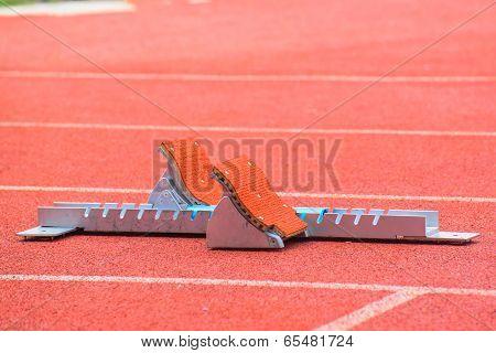 the starting blocks on running tracks