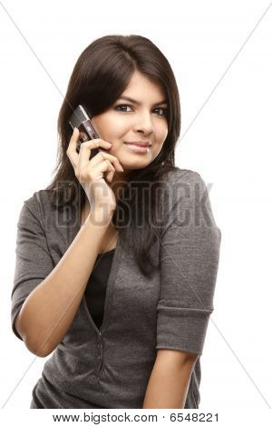 Young smiling woman calling by phone.