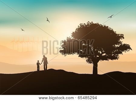 Silhouette of a father and son walking in the countryside