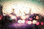 raindrops on glass. Outside the window the evening street poster