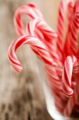 Candy canes with red and white stripes poster