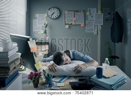 Businessman Sleeping In The Office Overnight