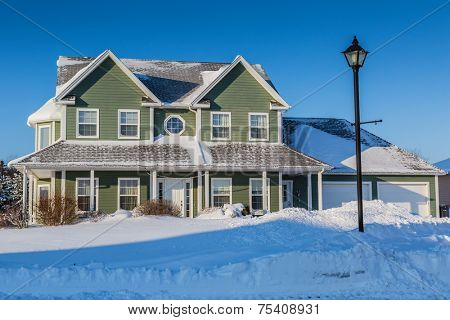 A typical north American family home after a snow storm.