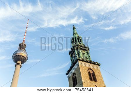 Fernsegtower Alex in Berlin with St. Marys church under blue sky poster