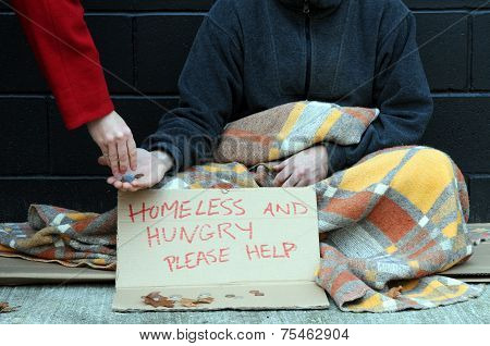Homeless man holds out hand, begging for change poster