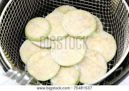 Zucchini in deep fryer, closeup