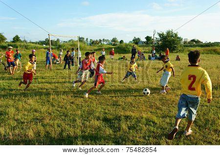 Asian Kid Playing Football, Physical Education