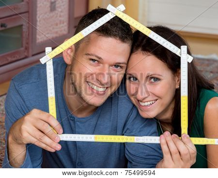 a young couple is looking forward to the construction of a detached house