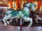 this gorgeous white carousel horse with a emerald green saddle brings us back to the old fashioned good old days. poster