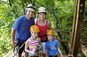 Family enjoying a Zipline Adventure on Vacation poster