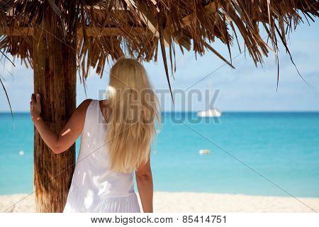 Girl Under Palm Leaf Umbrella