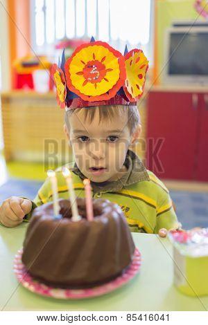 Little cute boy having birthday party at kindergarden