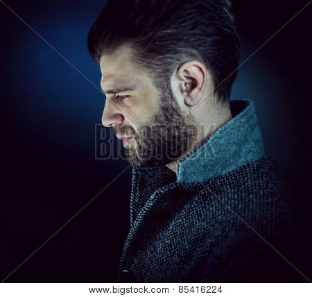 Artistic portrait of andsome young man with beard