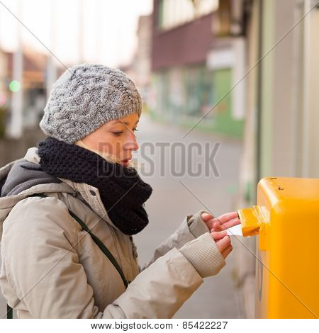 Young lady posting letters.