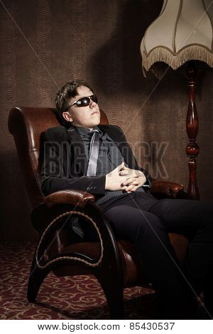 Elegant Teenage Boy Sitting In Arm-chair