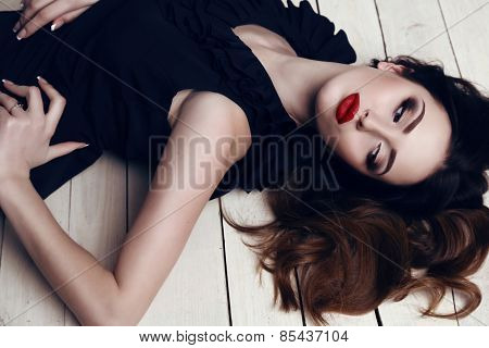 Beautiful Woman With Dark Hair And Bright Makeup