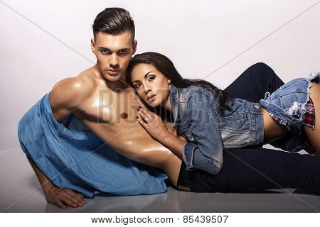 Sexy Impassioned Couple In Jeans Clothes Posing In Studio