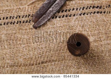 real old reel spool with  scissors on old grain sacking linen Completely hand made  handwoven and homespun