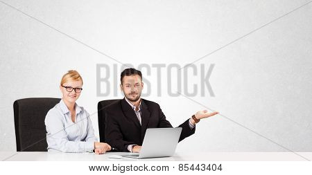 Young businessman and businesswoman with plain white copy space