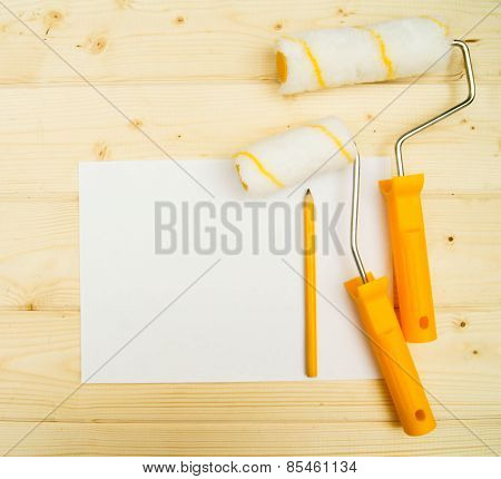 platen for paint on wooden background.