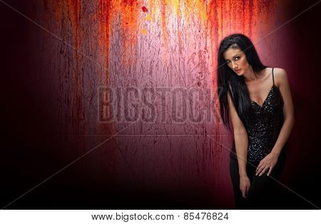 Attractive brunette woman in a black posing dramatic on purple background with red runoffs