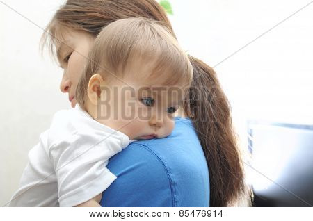 Baby Laying Head On Mother's Arm