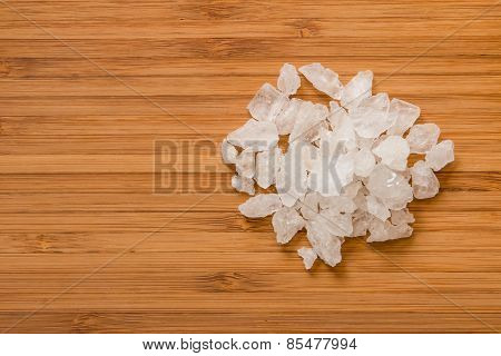 Rock Sugar On Brown Wood