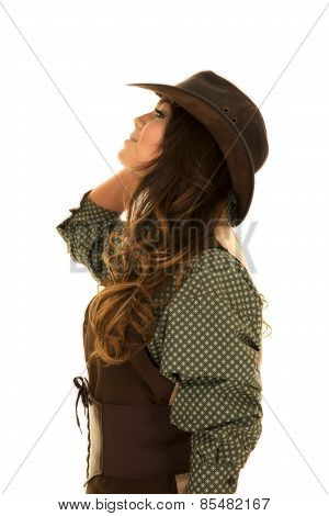 Cowgirl In Vest And Hat Look Up Side