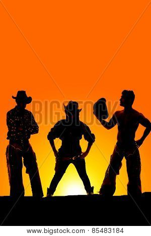 Silhouette Of Cowgirl Straight On Between Two Cowboys