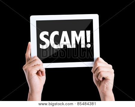 Tablet pc with text Scam! isolated on black background
