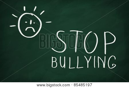 On the blackboard draw character and write Stop bullying poster