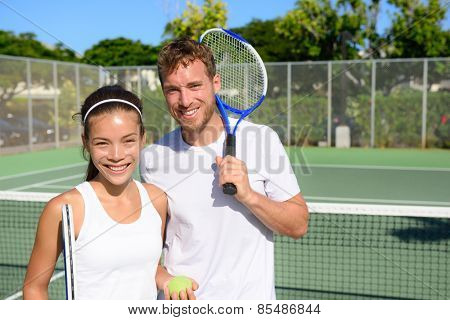 Tennis players portrait on tennis court outdoor. Couple or mixed double tennis partners after playing tennis outside in summer. Happy young people, woman and man living healthy active sport lifestyle. poster